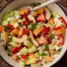 Feta cheese and red wine vinegar add a savory twist to this simple fruit salad.