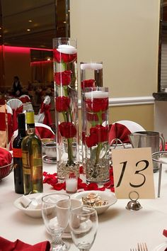 love the cylinder centerpieces