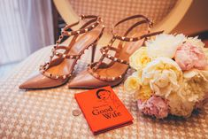 """Bride's chair with studded stilettos, rose bouquet, and book entitled """"How To Be A Good Wife"""" Stella Mccartney, Looking For Marriage, Moda Floral, Trends 2018, Grit And Grace, Indian Wife, Heel Pain, Good Wife, Happy Wife"""