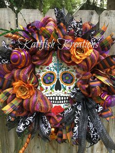 Sugar Skull Wreath, Day of the Dead Wreath, Dia De Los Muertos Wreath, Halloween Wreath, Door Hanger, Front Door, Wall Hanging, Sugar Skull Home Decor  Beautiful, colorful Day of the Dead Sugar Skull deco mesh wreath. The focal point of this gorgeous wreath is the sturdy metal sugar skull. Surrounded by premium orange and purple metallic deco mesh, four types and colors of wired ribbon, two large shatterproof orange and purple glitter ornaments, one large shatterproof orange polka dot…