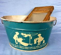 Vintages tin toy washtub with  wood and glass washboard.