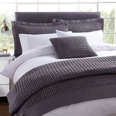 Crafted in a dark charcoal grey with a textured finish, this sophisticated Hotel quilted bedspread features a hollowfibre filling and is available in a choice of sizes.