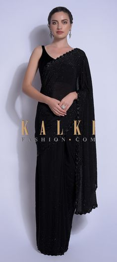 Raven black saree in chiffon embellished with kundan work. Further enhanced with cut dana work on the zigzag cut hemline and pallu. Dress Indian Style, Indian Dresses, Indian Outfits, Chiffon Saree Party Wear, Party Wear Sarees, Trendy Sarees, Stylish Sarees, Cotton Saree Designs, Saree Blouse Designs