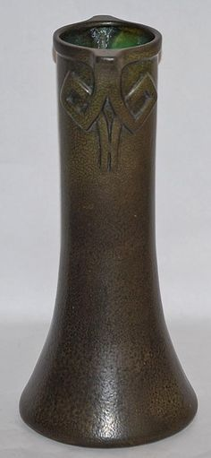 Louis, Missouri, c. matte green Arts and Crafts tall vase with Celtic knot, tab handles