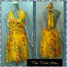 """LAVENDER BROWN Summer Halter Yellow Dress Size M elcome to The Trunk Show  BRAND: LAVENDER BROWN SIZE: MEDIUM COLOR: YELLOW MULTI PRE-LOVED  Gorgeous yellow floral multi color dress by LAVENDER BROWN. Sexy low halter dress with tones of blue over a yellow background. Back zipper closure and wide ties at the neckline. In very good condition!  ,APPROXIMATE GARMENT MEASUREMENTS LAYING FLAT  Bust 36 Waist 29 Hips free Length 20"""" (The lengthFrom top of waistband to hem)  Sorry no trades Xoxo…"""