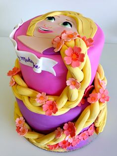 With Love & Confection~ My client gave me the idea of wrapping Rapunzel's braid around a two tiered cake. We created a 1 tier version of this design but for some reason THIS two tiered version has attracted such overwhelming admiration around the world.