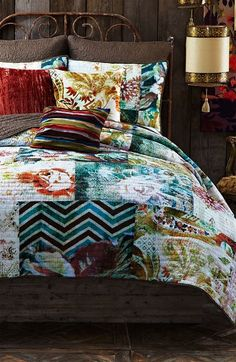 Love the mixed patterns on this patchwork quilt.