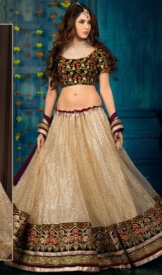 Step out in style in this beige color net chiffon satin embroidered choli skirt. You will see some interesting patterns performed with lace, stones and resham work. #floralworklehangas #fabulousdesigncholie #netflaredlehangacholis