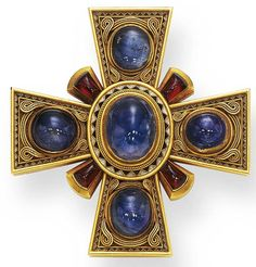 AN ANTIQUE SAPPHIRE, GARNET AND GOLD MALTESE CROSS BROOCH   Centering upon an oval cabochon sapphire, within a white and blue enamel frame, accented by gold wirework, each similarly-set arm alternating with cabochon garnets, the reverse enhanced by decorative engraving, mounted in gold, (with retractable pendant loop for suspension), circa 1870