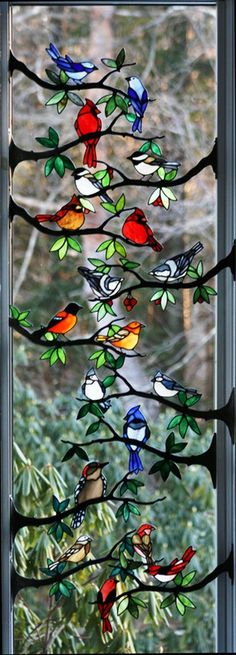 Beautiful stained glass window! I love this so much!  Maybe someday ill copy it with the fake stained glass paint you can buy at the craft store.