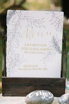 gold calligraphy wedding reception menu #weddingreception #menu #weddingchicks http://www.weddingchicks.com/2014/01/28/natural-gold-wedding-ideas/