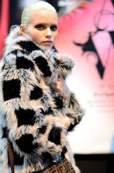 Abbey Lee bundles up in a patterned faux fur coat.