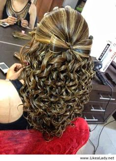 Amazing bow made out of hair and curls