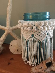 Macrame jar that could be used as a vase or lantern. It would be nice to hold small treasures that you find at the beach, on a hike, or from your favorite little shop! It pairs nicely with other macrame decorator pieces. (Especially found in my Etsy shop!) - Handmade - Ball jar - blue