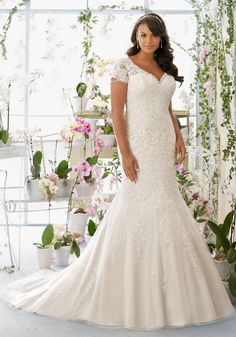 Juliettta Collection by Morilee: Crystal, Pearl Chandelier Beading on Net Dress with Alençon Lace Appliqués Over Soft Satin Plus Size Wedding Dress.