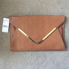 "Steve Madden Large Cognac Clutch Steve Madden Large Cognac Clutch. Measures 13""X 9"" and opens about 1"". Has chain strap if you want to use as purse. Steve Madden Bags Clutches & Wristlets"