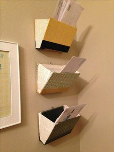 Old books, but use for a way to sort mail, not on the wall but like Allo's cute separator