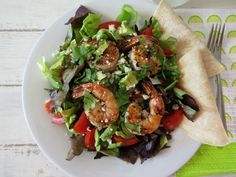 Garlic Lime Shrimp Salad - A healthy garlic and lime grilled shrimp salad topped with a cilantro lime vinaigrette dressing.