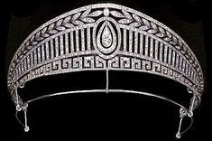The 'peregrinations' of the 'Prussian' belle epoque tiara, 1913. This fabulous diamond tiara has made its way round several Royal Families of Europe in the past hundred years or so. Starting with a base of Greek Key motifs, then upright diamonds, to a band of laurel leaves, with a lovely pear-shaped diamond at its centre