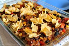 This Enchilada Casserole is easier to make than enchiladas since you don't need to roll tortillas or make a separate sauce. Corn tortillas are added to the top, making corn chips during baking, as well as in with the beans and vegetables to thicken the casserole. This is a dish that everyone at the table will enjoy! (vegan, SOS-free)