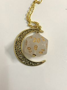 Moon D20 dice pendant ____________________________________________________________________________   Ready to ship    D20 dice pendant with moon. Chain included.  I used D20 dice, it was drilled by me and attached to a chain and moon.   You can find more dice accessories in my shop: