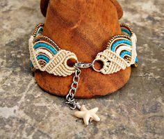 Closure of macrame bracelet with starfish charm.