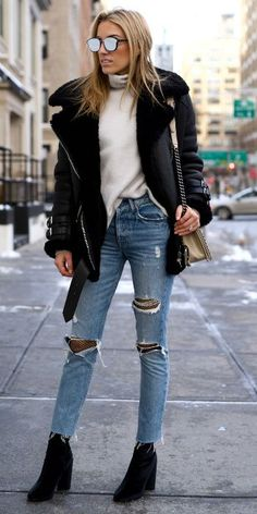 Stunning us + Shearling coat + Lisa D Cahue + winter trends + distressed denim + turtleneck + heeled boots + gorgeous   seasonal look  Jeans: Grlfrnd, Fishnets: Topshop, Coat: Acne Studios, Sweater: J Brand, Boots: Public Desire.