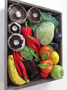 """Mixed Fruit & Veg Market Box"" - a side view of one of my mixed media ceramic & reclaimed wood pieces.  #interiordesignideas #raku #ceramics #reclaimedwood #mixedmedia #prints #kitchen #diningroom #restaurant #limitededition #handembellished #wallart #MiltonKeynes #vegbox #fruitbox #marketbox #studio #openstudio #artist #creative #mushrooms #cabbage #peppers #mixedveg"