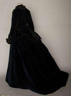 "2-piece blue-black velvet, apron front & back bodice w/ black silk trim,trained skirt, brown cotton bodice lining, B 34"", W 26"", Skirt L 40""-56"","