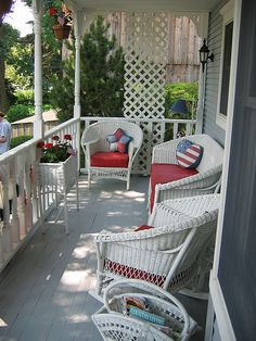 Patriotic porch..........Sylvan Lake home and garden tour a collection of vintage wicker furniture.