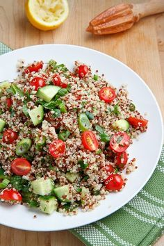 Quinoa Tabbouleh Salad>>>  2 cups water>>   1 cup quinoa, rinsed>>   1 cup tomato, diced>>   1 cup cucumber, diced>>   1/2 cup parsley, chopped>>   1/4 cup mint, chopped>>   1/4 cup green onions, chopped>>   1/4 cup lemon juice>>   2 tablespoons extra-virgin olive oil>>   1/2 teaspoon cumin, >> salt>> and pepper to taste