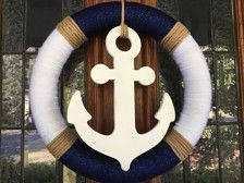 This nautical wreath is made with wrapped yarn and rope. Perfect for any ocean lover