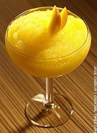 Vodka Mangorita Ingredients:- 1 1/2 oz Finlandia mango vodka- 1/4 oz Cointreau- 2 oz sweet & sour mix- 1/4 oz lime juiceGarnish: mango sliceMix all ingredients in a cocktail shaker with ice. Strain into a chilled margarita glass.