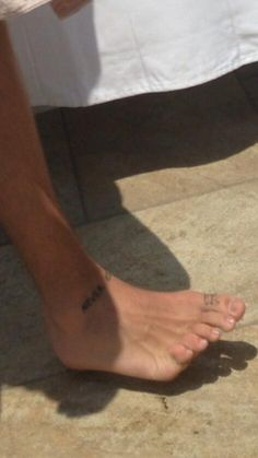 Harry's ankle tattoo! Never give up is what I think it says!