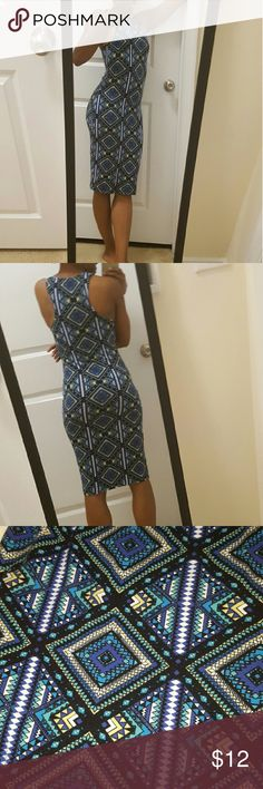 Fitted midi dress Form fitting cute print midi dress. Tag says Medium but fits a small well. Had alot of stretch to it. Great with sneakers n a jean jacket to run errands. love chesley Dresses Midi