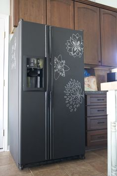 Now that is cute!- perfect for an old fridge....Took about 3 coats of chalkboard paint. Total cost: $13