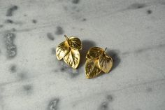 Handmade/earrings/base metal/gold plated/24 carats/3 leaves by CrownedCharm on Etsy