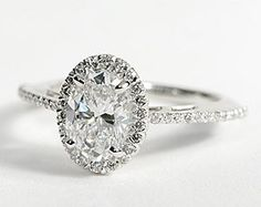 Take the halo off and this is stunning. Love the oval with the delicate band.
