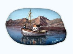 a boat on the water - a painted rock