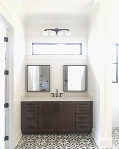 Who says you need to center your mirror(s)? I love my master vanity! The schoolhouse style fixture, black and white pattern tile, and natural light all work perfectly together!