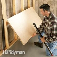 If your garage isn't big enough for your car and a workbench, you could build a fold-down workbench. This one sets up in seconds and eats up zero floor space when not in use. The only things you'll need are a 2x4, a pair of beefy hinges, a couple of threaded pipes and flanges, and a handful of screws (about $30 altogether).