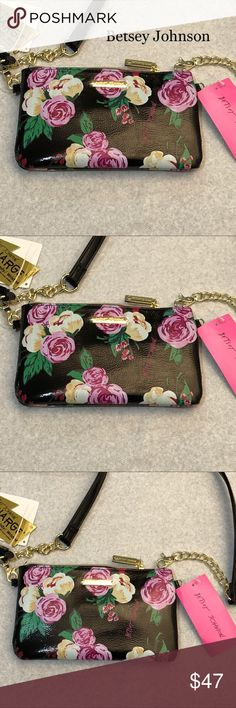 "Betsey Johnson charging crossbody/wristlet - NWT Beautiful Betsey Johnson, floral ""I'm in Charge"" charging crossbody/wristlet. Signature gold hardware with removable crossbody strap.  The inside is fully lined with Betsy Jonson floral design, and 6 card slots.  Approximate measurements: strap is 23"" drop, 8 1/2"" x 5"" x .075"" Detachable (2 magnetic snaps) 1000 mph charging power bank.  Dual tip micro USB with lightening attachment.  Compatible with all smartphones.  Approximately 3 hours of…"