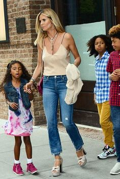Heidi Klum wearing Amo Babe High Rise Crop Jeans in Dive Bar Destroy and Saint Laurent Candy Leather Platform Sandals