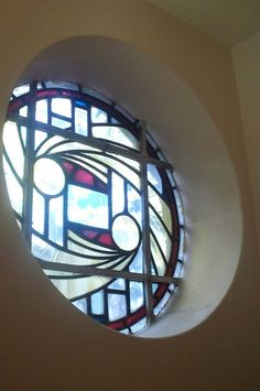 Stained glass round window  would love to have this at the first landing on my stairs.