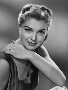 Esther Williams photos, including production stills, premiere photos and other event photos, publicity photos, behind-the-scenes, and more.