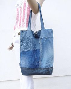 One of a kind handmade denim tote bag. Very unusual and stylish tote! Like a canvas tote but in jeans design! Raw edges, different shades of denim, some flower pattern added by bleaching technique. For you to stand out, as it is truly unique thing! Recycled denim. I do my bit to save the