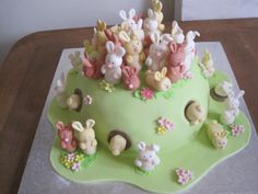 """How many bunnies? - This is a vanilla madeira cake, covered in sugarpaste - covered in lots of little bunnies, some going down holes. it was for a school fair """"guess how many bunnies on the cake?"""" - kids loved it. one major mistake though - was a bit rushed and forgot their whiskers!!!"""