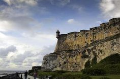 Old walls of El Morro in late afternoon light with blue sky, Old San Juan, Puerto Rico - Bob Stefko/Photographer's Choice/Getty Images