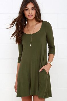 Run the world with the Twirl Power Olive Green Swing Dress! Jersey knit three-quarter sleeve dress has a relaxed silhouette. Green Dresses For Sale, Green Formal Dresses, Olive Green Dresses, Green Dress Casual, Casual Dresses, Green Shirt Dress, Olive Dress, Online Dress Shopping, Winter Dresses