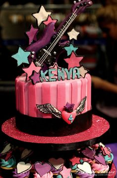 Rock Star Birthday Cake, Cupcakes, & Cake Pops I made for a very special client and family. It was super fun. Everything is edible, even the guitar! All decor is made of a mix of fondant, pure chocolate and modeling chocolate. Demo of how to make your own guitar is coming soon to my blog. Please check it out if you are interested: www.fernandaabarca.com/sweets